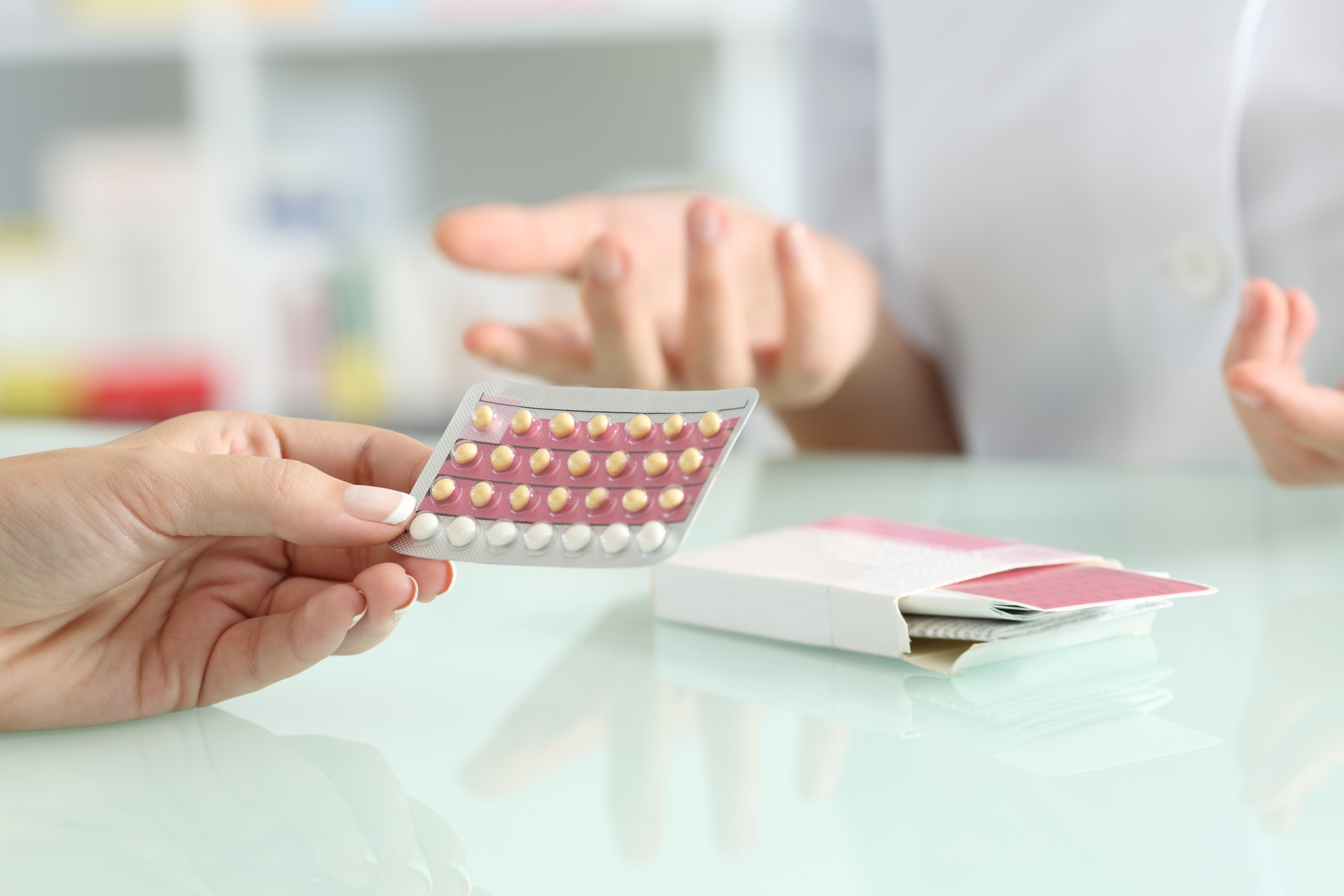 girl-buying-contraceptive-pills-in-a-pharmacy